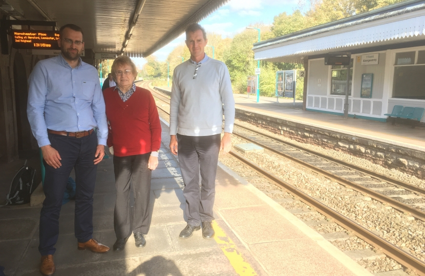 Monmouth MP David Davies with County Cllr Maureen Powell and a Network Rail official.